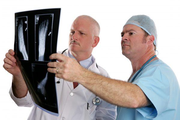 Doctors examining a podiatry x-ray result